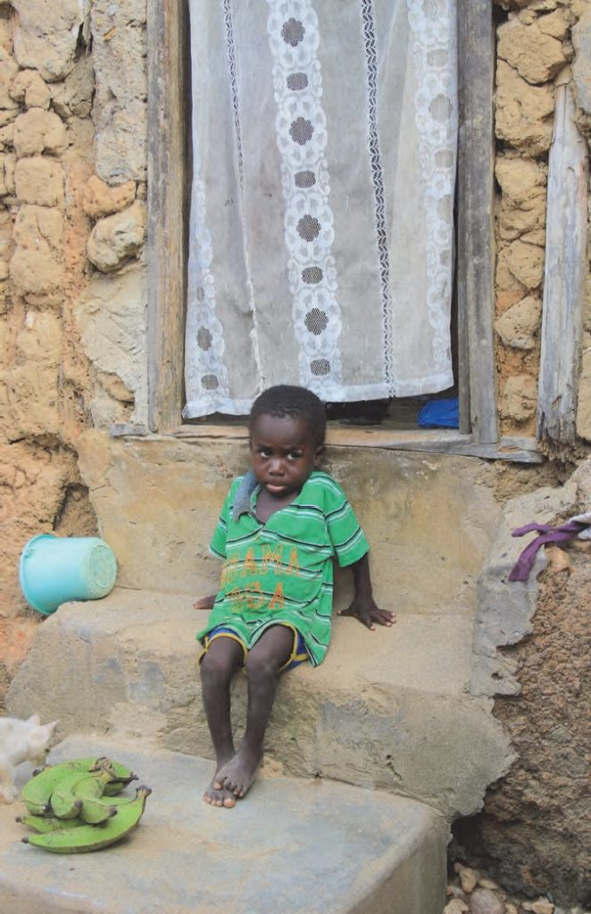 """""""Ghanaian Boy and His Home"""" photograph"""